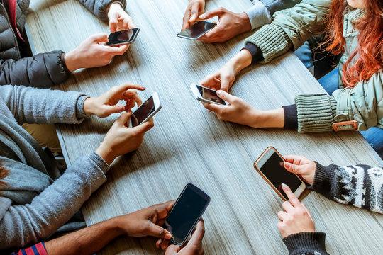 friends using smart phones top view