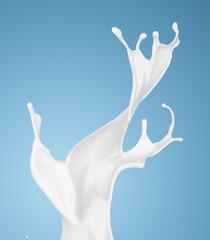 milk or white liquid splash on blue background