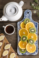 Breakfast crackers with chocolate paste and bananas, coffee and fruit