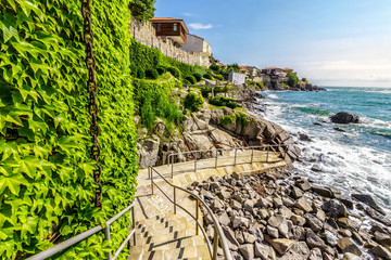 steps to the rocky shore from the old town