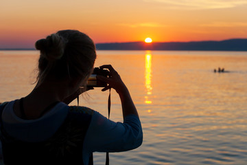 Photographing a sunset at a lake