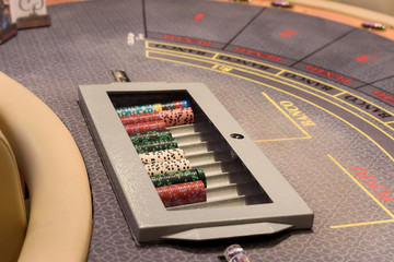 closeup of poker table with chips