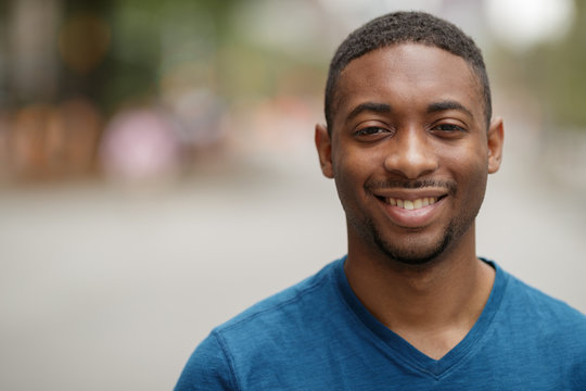 Young black man in city smile happy face