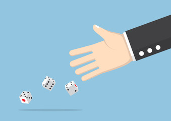 Businessman hand throwing dice