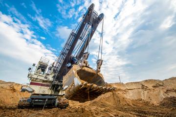 Huge excavator ground moving