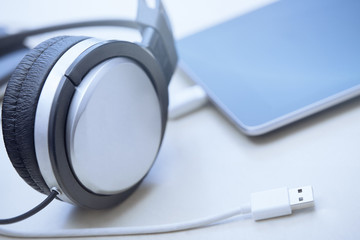 Headphones digital tablet and USB cable
