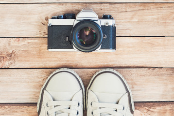 Main accessories of hipster photographer. Photo camera and shoes