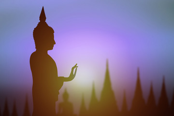 Recess Fitting Buddha Silhouette of Buddha.Background sunrise