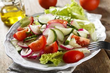 Vegetable salad with olive oil dressing