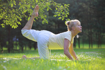 Yoga woman in park