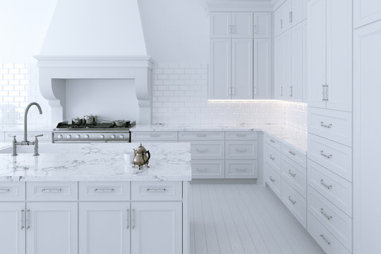 Luxurious white kitchen cabinet with cooking island.