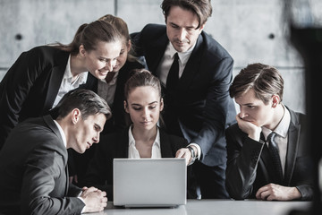 Business people look at laptop