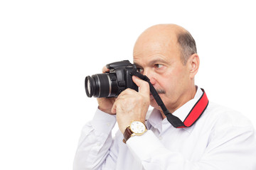 elderly man tries to understand the complex camera settings