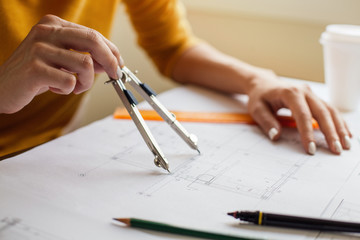 Woman hands doing technical drawing