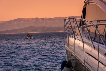 Yacht Croatia summer sunset. / Luxury yacht in sunset time with Island of Hvar in background, Croatia, summertime.