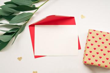 holiday theme. gift box, envelope on white background