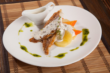 mackerel with sauce on plate