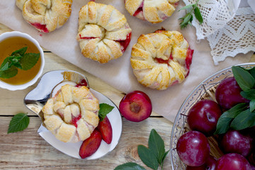 Flaky pastry with berry filling, biscuit malt and mint tea on a