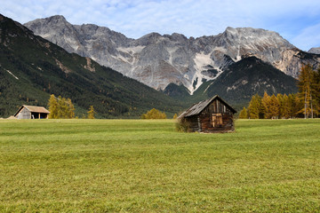 Old wooden hut in mountain at rural fall landscape. Mieminger Plateau, Austria, Europe.