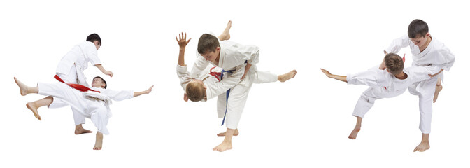 Two boys are trained judo throws