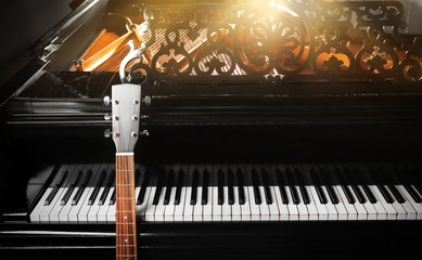 Guitar with piano, close up