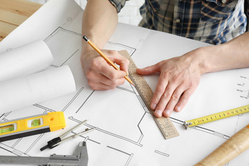 Man working with engineer blueprints