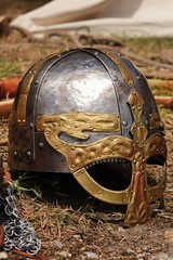 Decorative medieval helmet with gold embossed nose-piece and eye sight