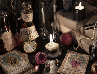 Close up of the tarot cards, magic books and candles