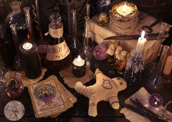 Mystic still life with voodoo doll, the tarot cards, witch books and magic objects