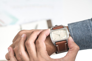 Businessman looking at his watch punctuality