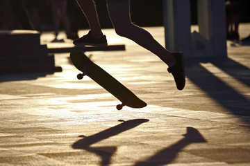 silhouette of your legs jumping skate