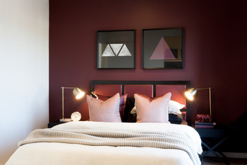 Classic bedroom closeup with flashing table lamps