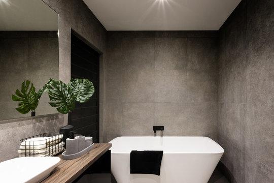 Modern bathroom wall made in dark color tiles