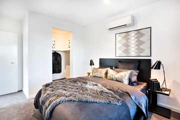 Dark and shiny decoration for a modern bed