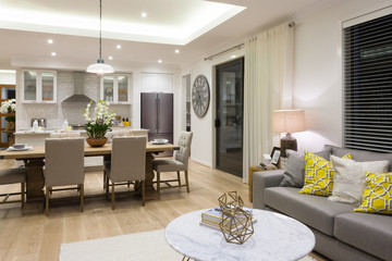 Luxury living room beside a dining room and the kitchen
