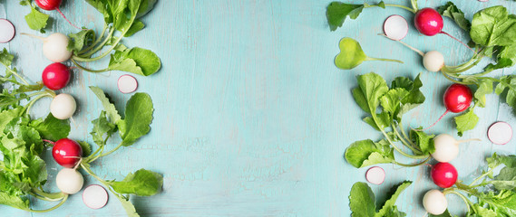Fresh radishes on light blue background, summer root vegetables, top view, banner