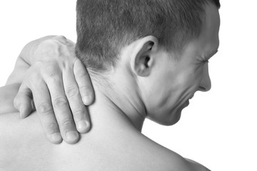 Man touching back of spine.Pain concept.Isolated on white