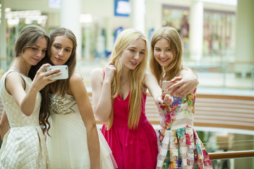 Beautiful, smiling women take a picture of herself with a smart