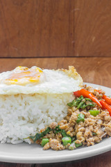 Rice topped with stir fried minced pork and basil. Thai food