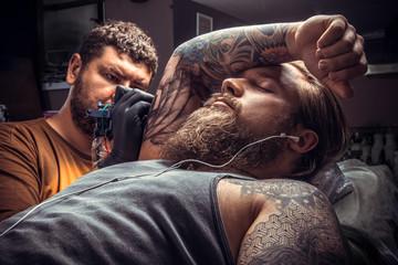 Man wearing gloves posing in tatoo salon
