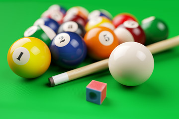 Group of billiard colored balls, cue and chalk on green table. 3