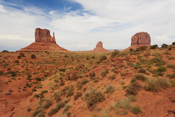 Walking in the Monument Valley with the West and East Mitten Buttes and as well as Merrick's Butte