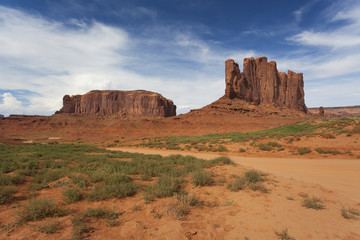 Interesting rock formations on a sunny blue day in Monument Valley, America