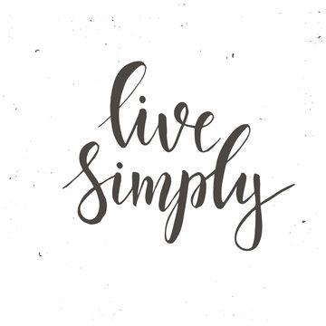 Live simply. Conceptual handwritten phrase