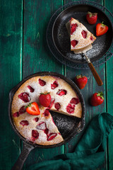 rstic summer strawberry  cake on cast iron pan