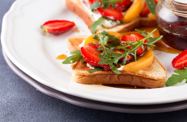 French toast with fresh strawberries and peaches