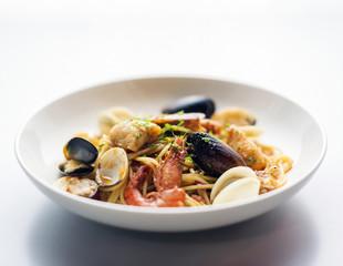 seafood and spicy puttanesca marinara tomato pasta