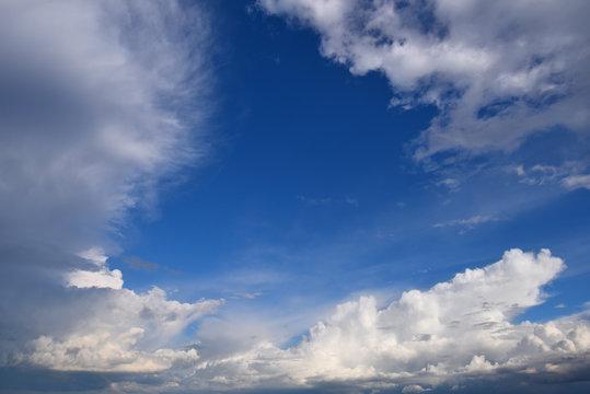 White clouds framing a blue sky