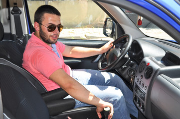 Bearded young driver