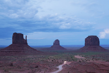 The West and East Mitten Buttes and Merrick's Butte at night in Monument Valley